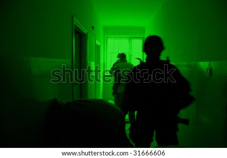POLAND - MARCH 28: View through the night vision device during a soldiers training (battle camp) to conduct an attack inside a building at night March 28, 2008 in Poland. - stock photo