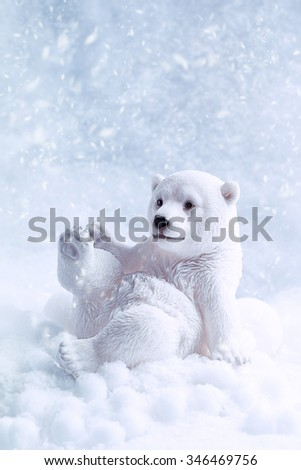 Polar bear figure in snow with cool tone