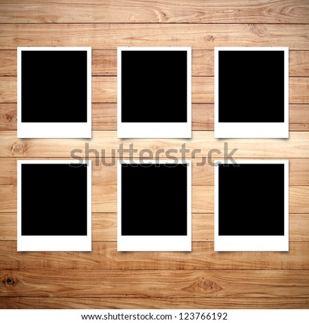 Polaroid photo frame on wood background - stock photo