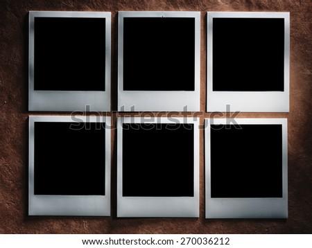 polaroid style photo frames on the very vintage paper - stock photo