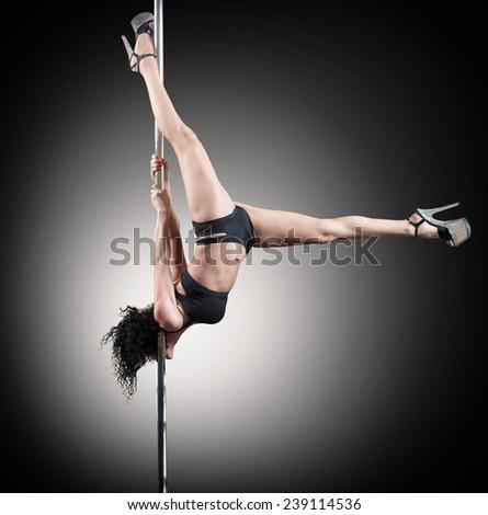 Pole dancer, woman dancing on pylon - stock photo