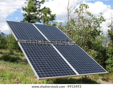 pole mounted photovoltaic solar panel collector array - stock photo