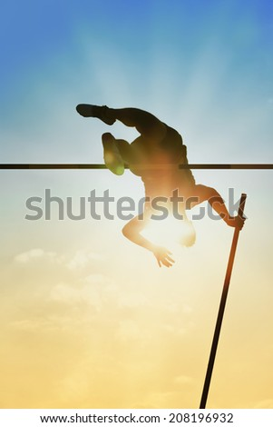 Pole vault over the bar with  back light - stock photo