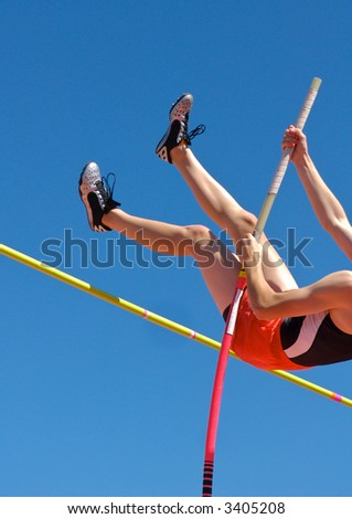 Polevaulter pulling over the pole vault crossbar - stock photo
