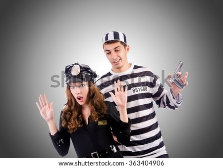 Police and prison inmate against the gradient - stock photo
