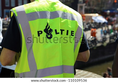 Police at Queensday in Amsterdam - stock photo