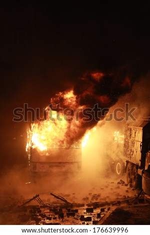 Police buses on fire. Kyiv, Ukraine, January 19, 2014 - stock photo