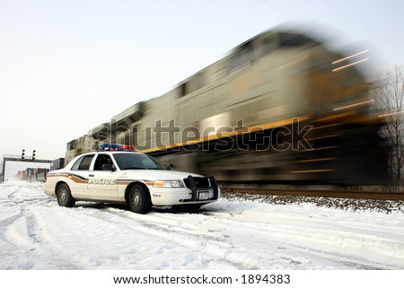 Police car and train
