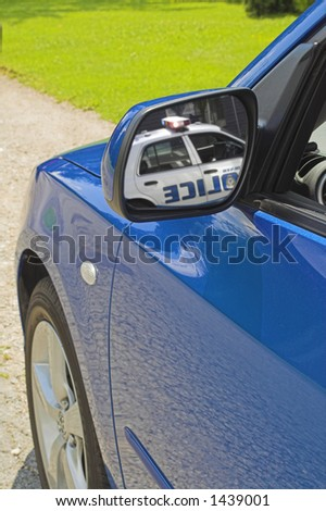 police car in mirror - stock photo