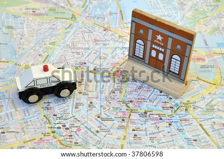 Police car on the map of the city - stock photo