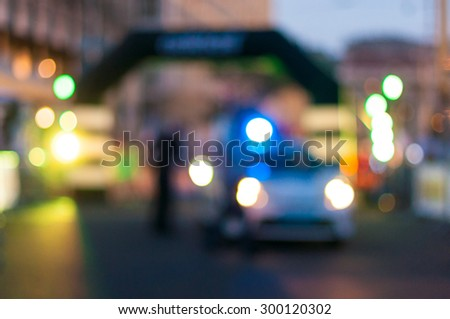 Police car on the street at night. - stock photo