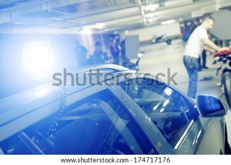 Police car with blue siren cought the bandits - stock photo