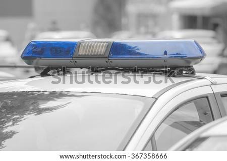 Police car with lights turned off. - stock photo