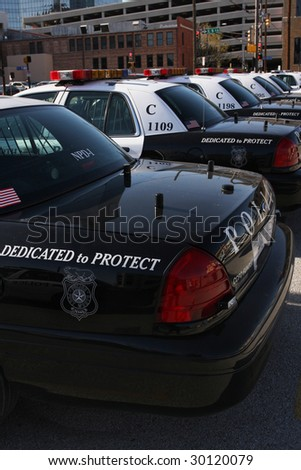 Police cars in parking lot - stock photo