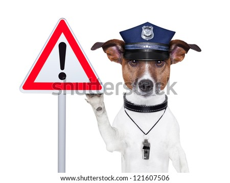 police dog with a street warning sign - stock photo