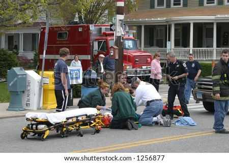 Police, EMTs and firemen at the scene of an accident. Editorial use only. - stock photo