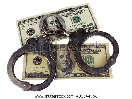 police handcuffs false and real hundred-dollar bill. concept of counterfeiting of money and punishment. - stock photo