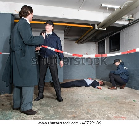 Police inspector identifying himself to a policeman when arriving at a crime scene - stock photo