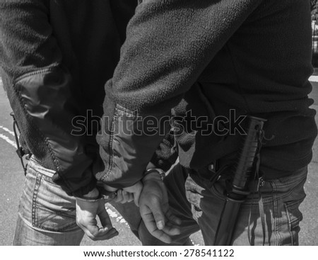 Police keeps a criminal with handcuffs