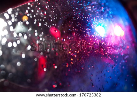 Police light reflection on rear-view mirror - stock photo