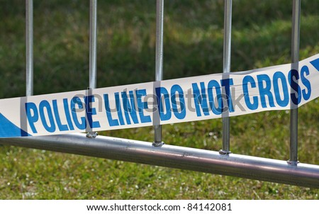 Police line do not cross barrier blocking off crime or accident  scene - stock photo