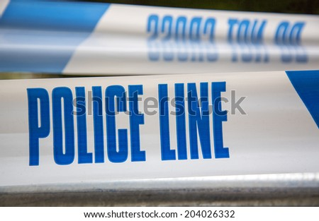 police line do not cross caution tape - stock photo