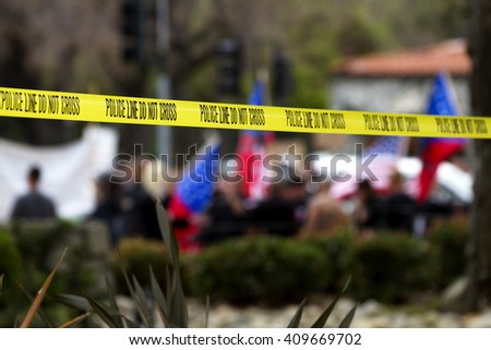 Police line tape used for crowd control at a peaceful protest. - stock photo