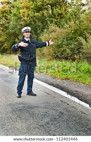 Police officer is doing a traffic control - stock photo