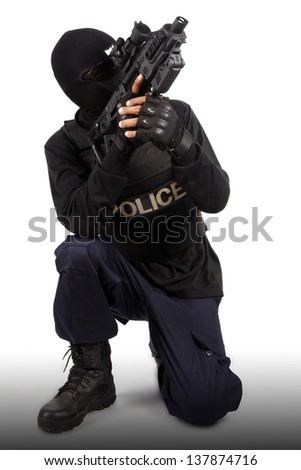 Police officer is holding with rifle on white background