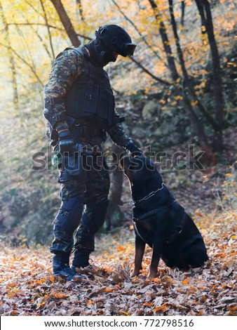 Police officer on duty,with his dog