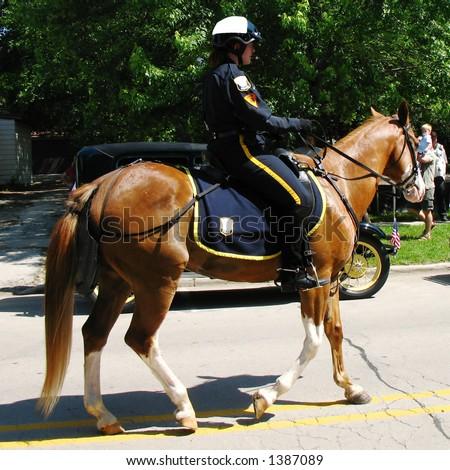 police officer on horseback - stock photo
