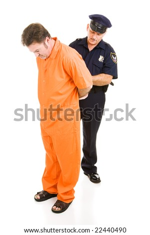 Police officer placing handcuffs on prisoner in orange prison jumpsuit.  Full body isolated on white. - stock photo