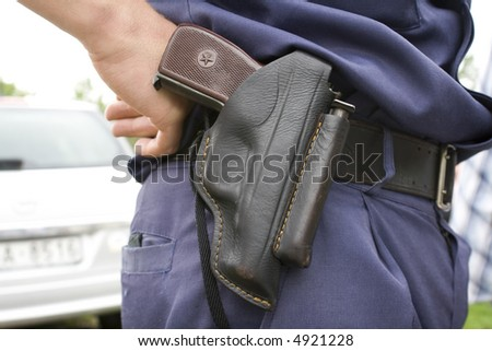 "Police officer`s holster with ""PM"" gun. - stock photo"