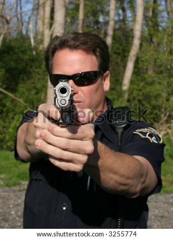 police officer taking aim - stock photo