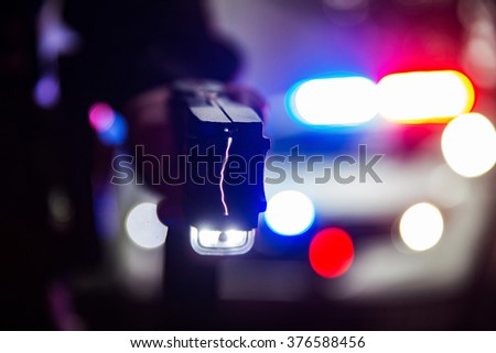 Police officer tazer - stock photo