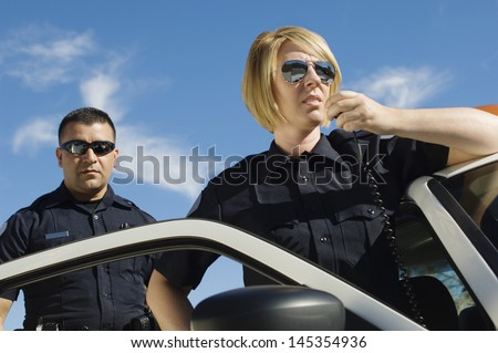 Police Officers Using Two-Way Radio - stock photo