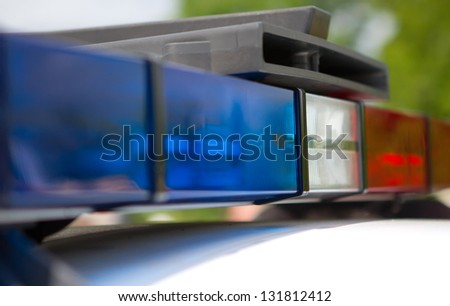 police red and blue roof lights - stock photo