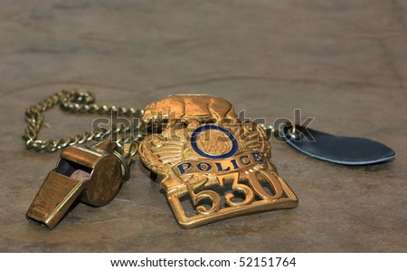 Police Shield and Whistle - stock photo