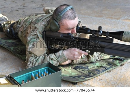 police sniper .50 caliber - stock photo