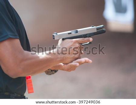Police special operations practicing in fire pistol shooting.  - stock photo