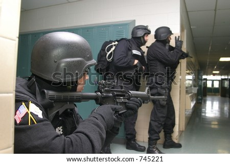 Police special tactics team during an anti-terrorism drill. Editorial use only. - stock photo