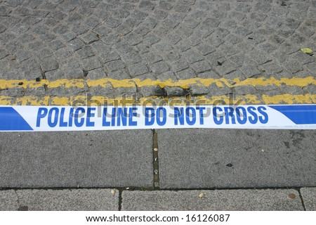 Police tape edging a road