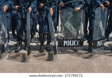 police Training in the use of batons to control crowds. - stock photo