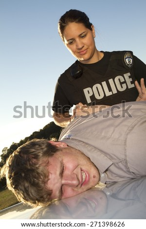 Police woman arresting man - stock photo