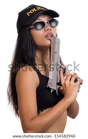 Police woman with a gun - stock photo