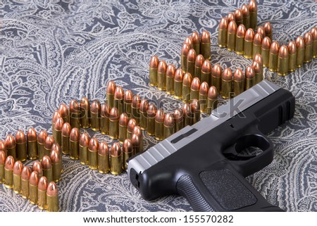 Police writing with bullets and a semi automatic gun next to it - stock photo