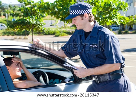 policeman chatting with driver - stock photo
