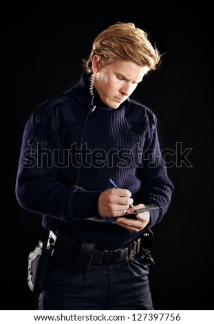 Policeman in uniform writing you a fine - stock photo