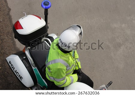 Policeman on motorbike standing on highway - stock photo