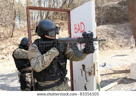 Policeman shoots assault rifle SA vz.58 - stock photo